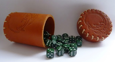 Leather dice cup and D6 dice.