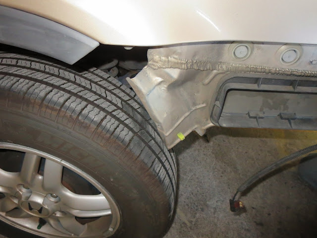Dented panel found behind bumper during auto body repairs on Honda CR-V