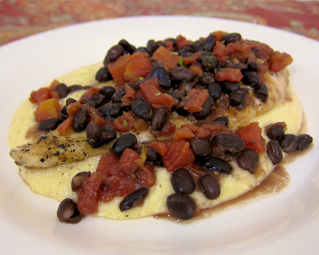 Beergaria Chicken over Chipotle Gouda Grits Recipe - chicken marinated in margarita mix, beer, and rotel, grilled and served over chipotle gouda grits and topped with spicy black beans. We literally licked our plates! Great mexican fiesta! My husband inhaled this and asked if I made extra - next time I will double the recipe. It is that good!