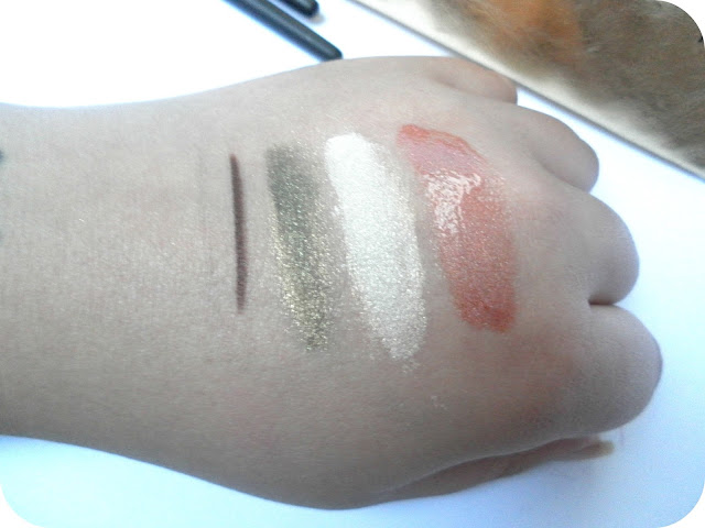 Swatches of the Inika Precious Metallics Gold Collection