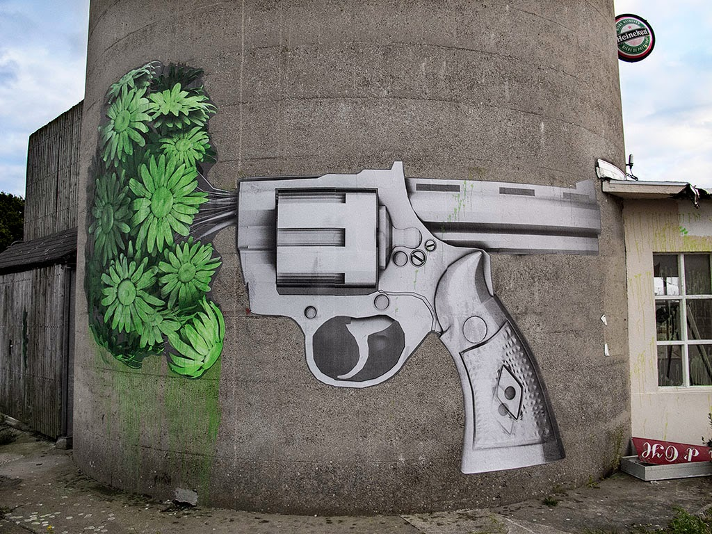 "Exploring the countryside of France over the week-end, Ludo just sent us a few images from his newest street piece which is entitled ""Both Sides Of A Gun""."