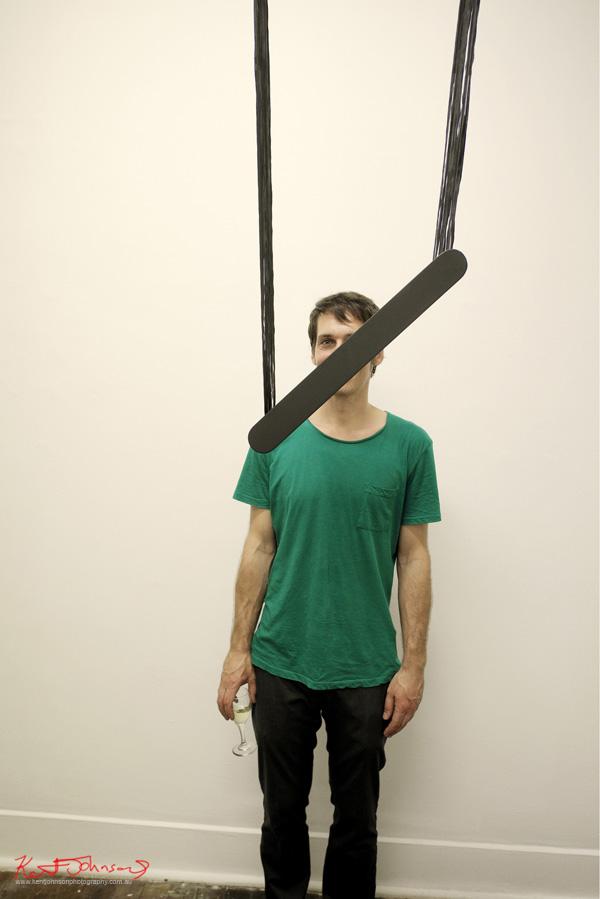 Arpad Forgo, Artist portrait, behind 'Black Bipolar' Installation piece, SNO 92