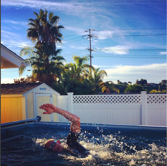Professional triathlete Luke McKenzie trains in his Elite Endless Pool.