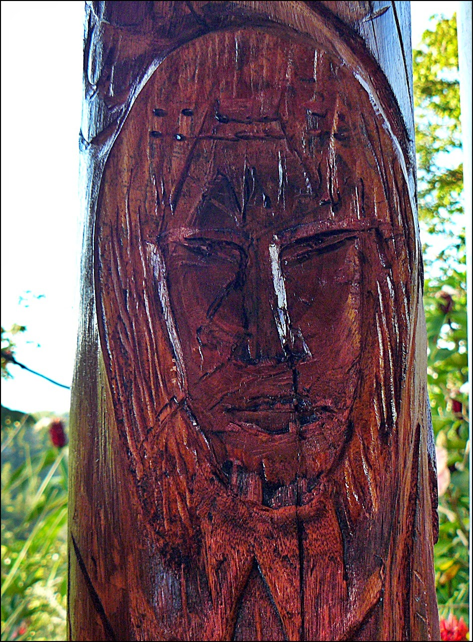 Close-up of indigenous person face in carving