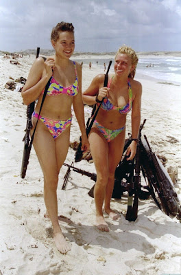 Israeli female soldiers traveling for leisure on the sandy beach with