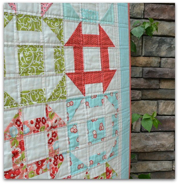 red aqua and green churn dash quilt