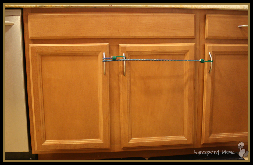 awesome How To Baby Proof Kitchen Cabinets #2: How to Baby-Proof with Bungee Cords