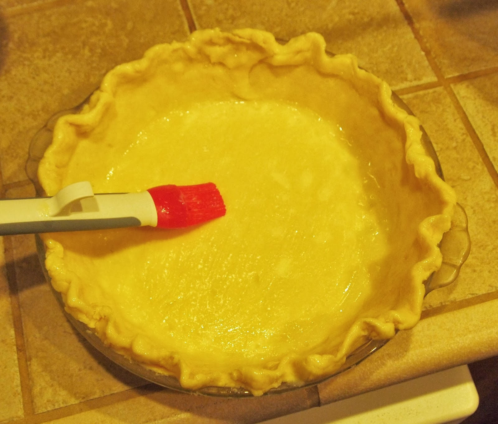 Brushing the crust with an egg (or an egg white, either way) gives the ...