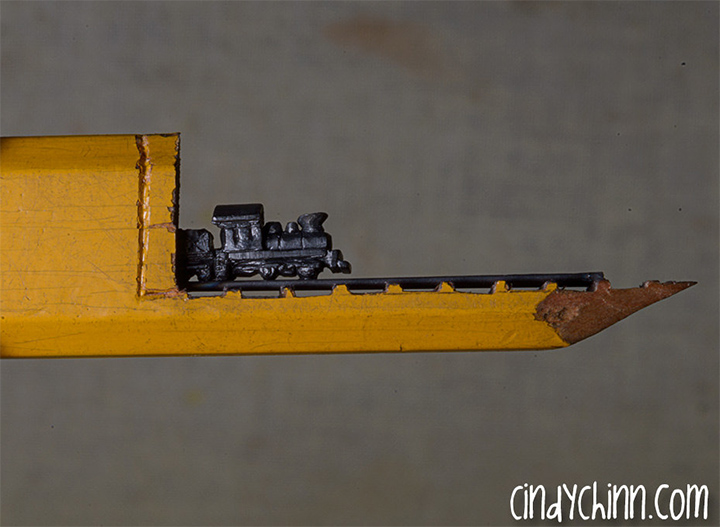 The tiniest train ever carved out of a pencil spicytec