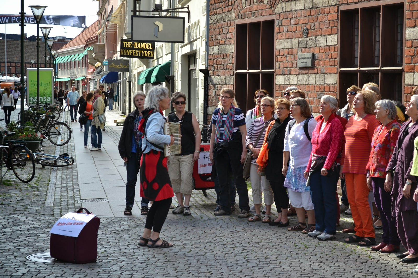 Street performer joined by locals , malmo