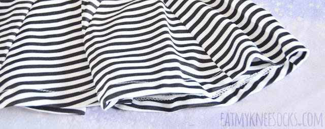 Details on Dresslink's striped zip-back cutout-waist V-neck accented skater dress.