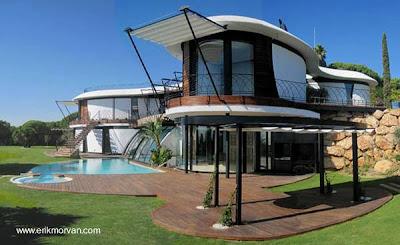 Casa contemporánea de lineas curvas en dos plantas