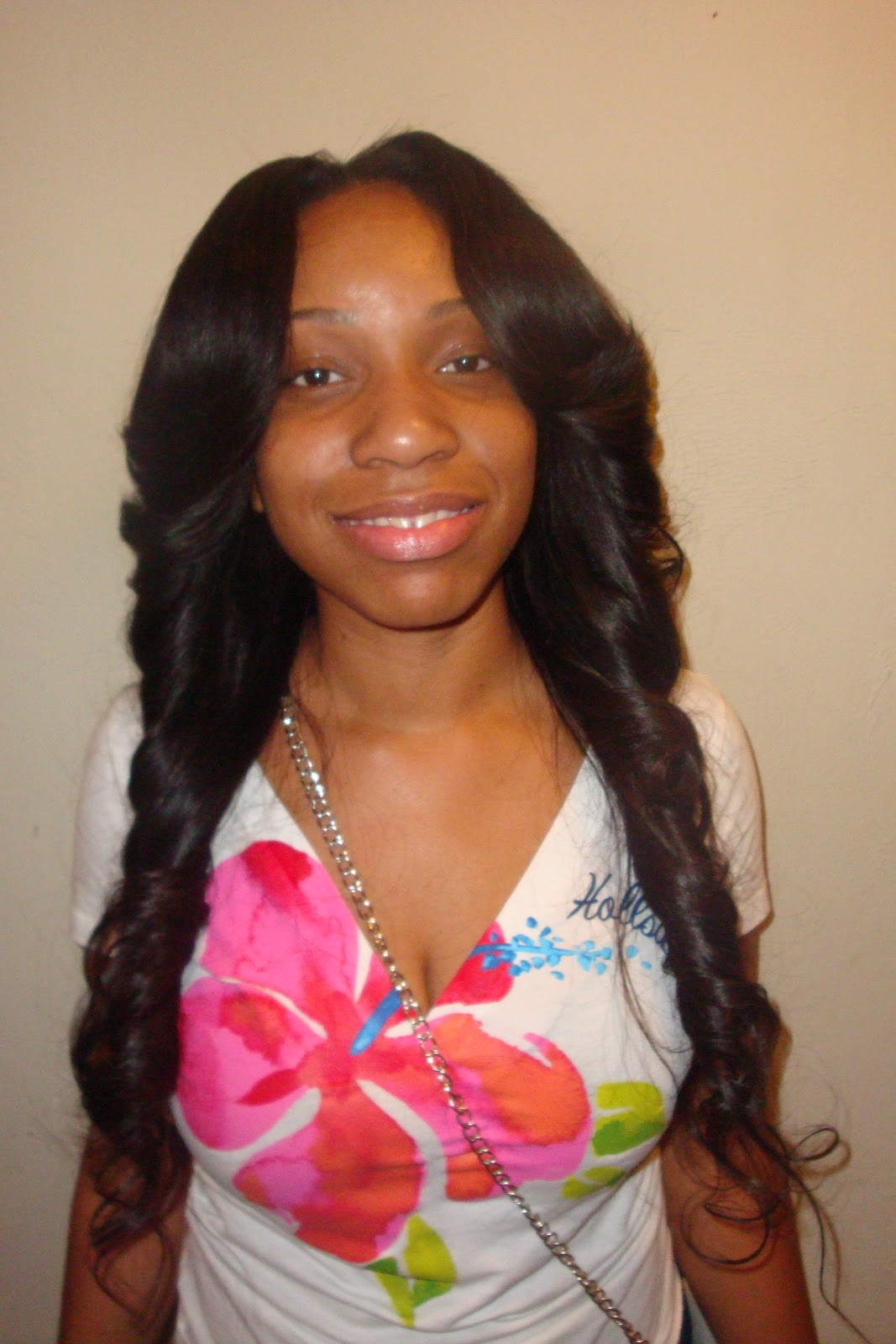 Sew-In with Brazilian Hair layered and curled