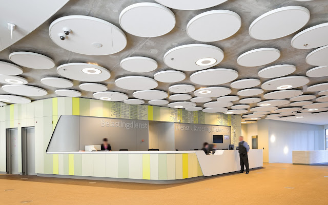 Picture of the lobby with concrete circles on the ceiling