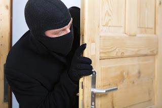 Thief entering apartment.
