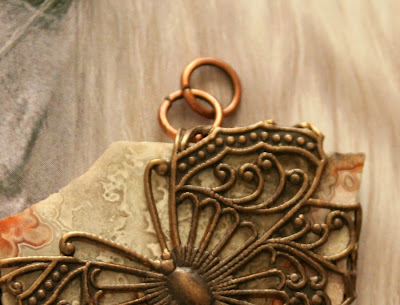 Flat stone wrapped in Vintaj filigree butterfly :: All Pretty Things