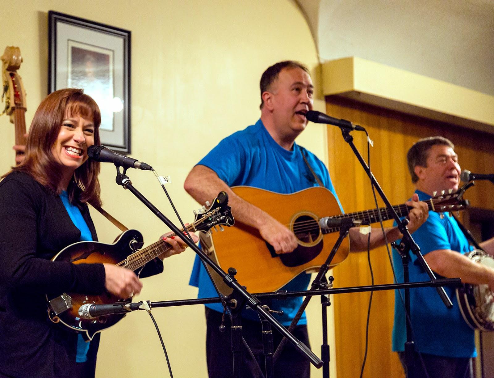 Three bluegrass band musicians