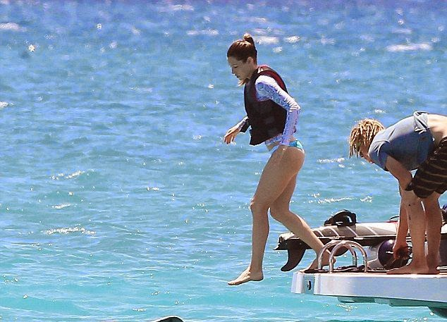 Jessica Biel showcases a Blue Bikini shapes as she takes to the ocean in Barbados