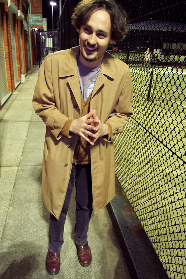 Mens cotton rain coat over mustard cardigan, print tee, cotton drill pants and brown shoes - Street Fashion Sydney