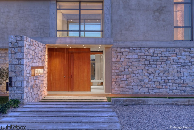 Stone house in anavissos by whitebox architects modern for Modern house stone exterior designs