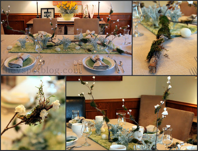A spring or Easter brunch tablescape using moss, branches, and flower buds.