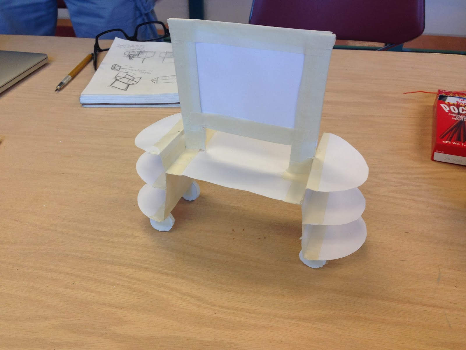 Image shows an angled view of the exhibit display paper model sitting on a table.