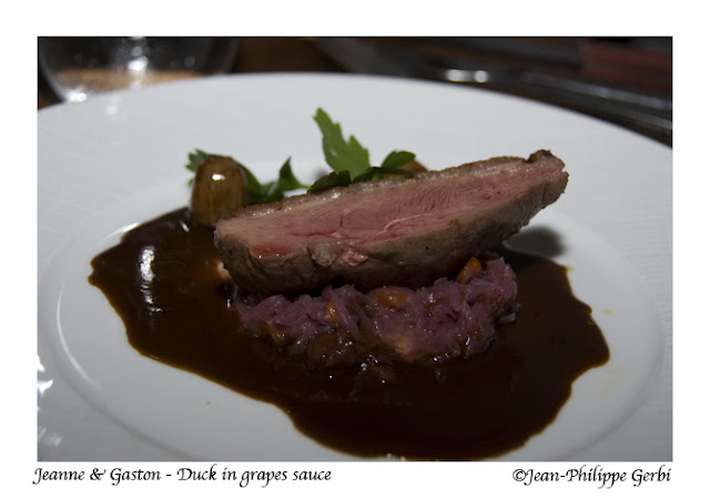 Image of Duck in grapes sauce at Jeanne et Gaston in NY, New York