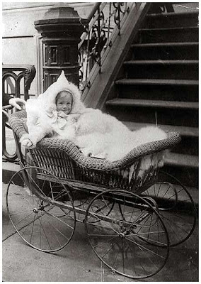 Young child in baby carriage. 1890