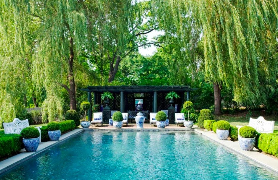 The glam pad decorating with blue and white outdoors for Gardens around pools