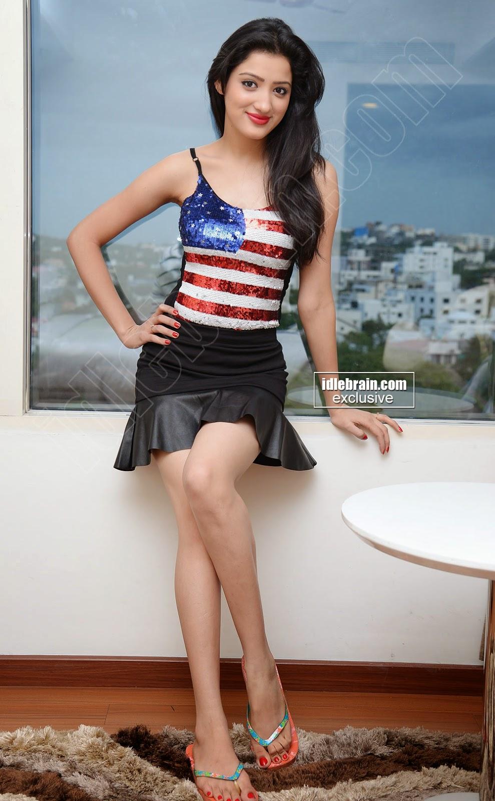Richa Panai black mini skirt thighs show