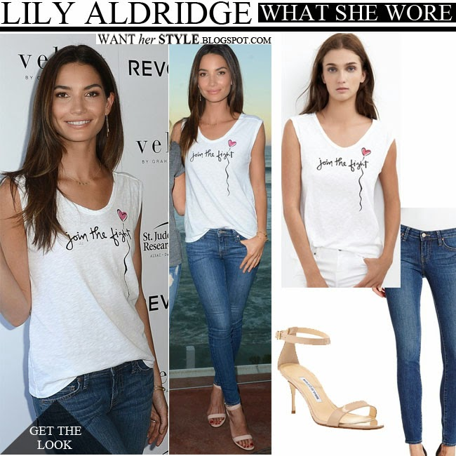 "Lily Aldridge in white muscle tee ""join the fight"" velvet with blue skinny jeans and beige strap sandals august 27 2014 want her style"