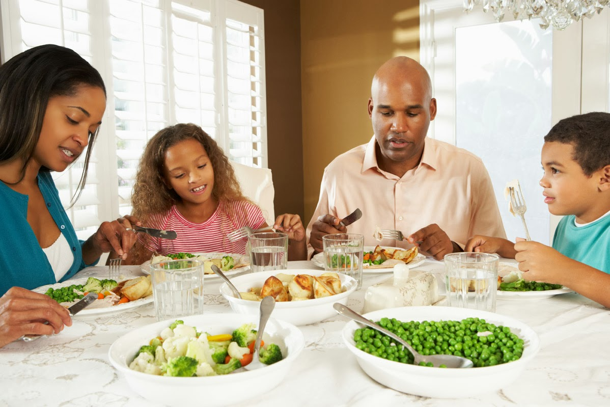 family enjoying healthy meal together