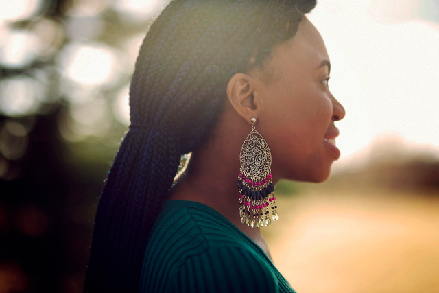 La Passion Voutee statement earrings and braids