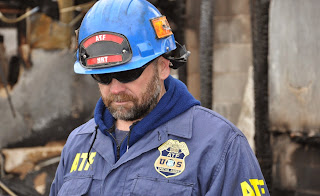 Special Agent Billy Magalassi working a fire scene as part of the ATF National Response Team.