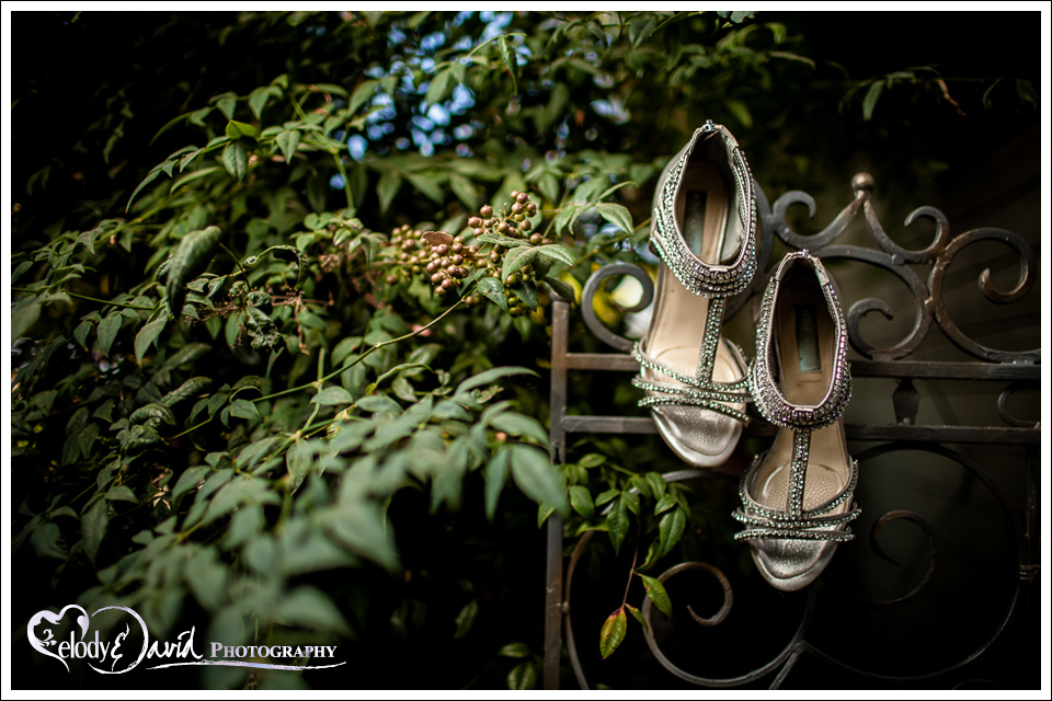 detail of wedding shoes shot outside on metal fence