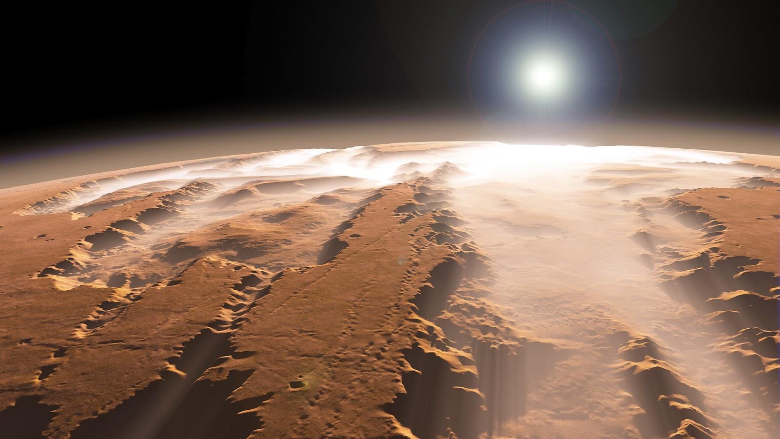 http://3.bp.blogspot.com/-VGFhEiUuUzE/UCY1M_xgjqI/AAAAAAAAMWU/l49TDR_yrpk/s1600/mars-wallpaper-canyon-sun-fog-planet.jpg