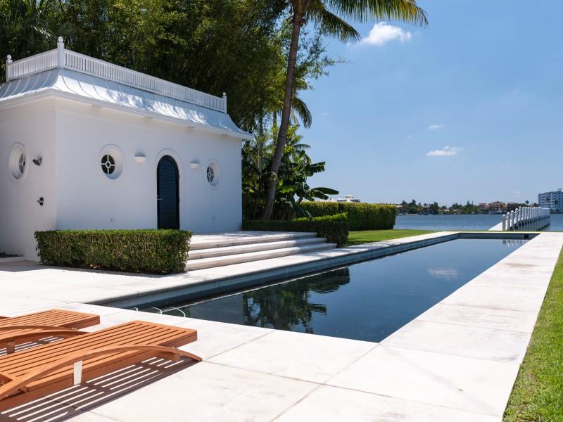 Backyard pool in a multi million dollar home