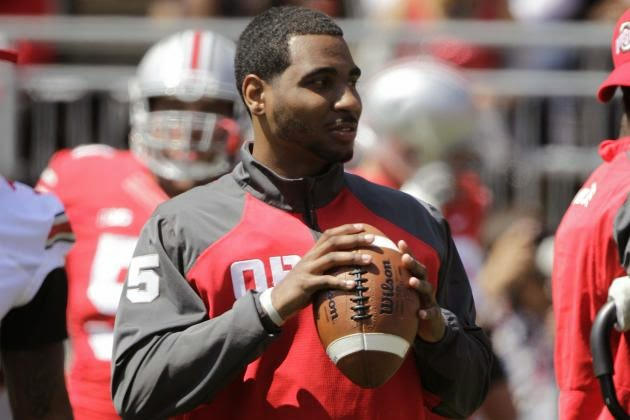 Ohio St. QB Braxton Miller reinjures right shoulder, could be out for season.