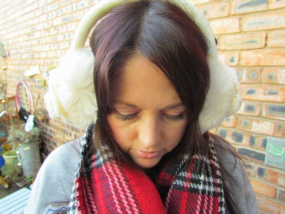 Cream earmuff headphones