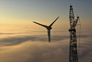 Wind turbine above the clouds