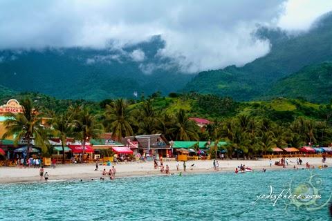 View of the white beach coast line of Puerto Galera