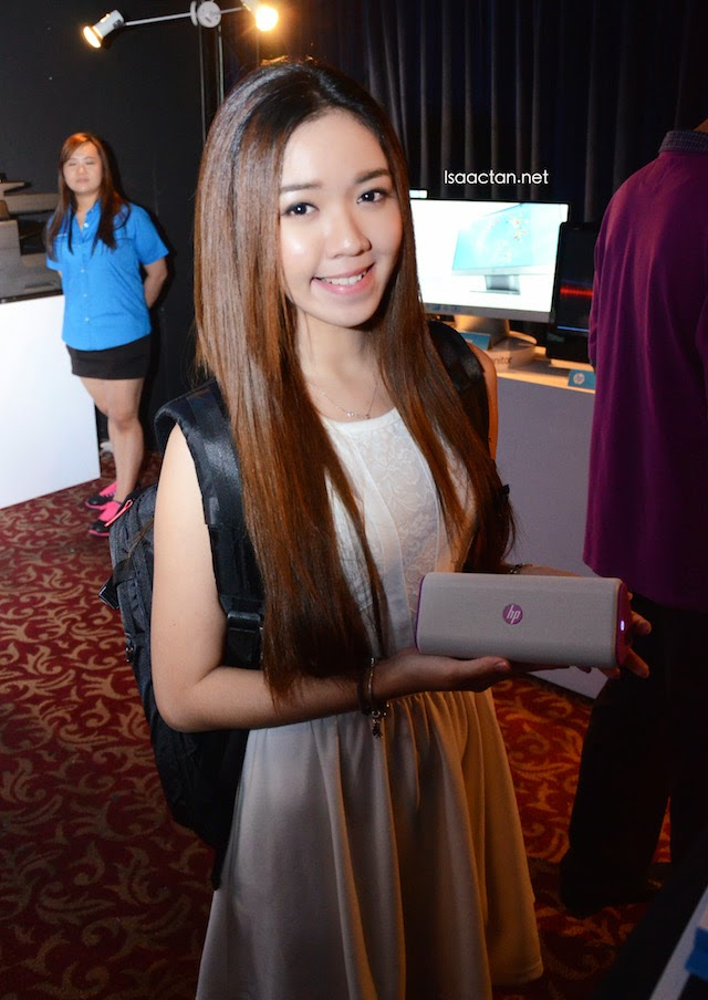 Pretty lady at the launch showcasing the backpack, and HP accessories.