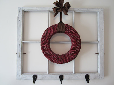 rustic window turned into a coat rack wall hanging