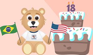 Ursinho caom bandeiras e bolo de aniversário