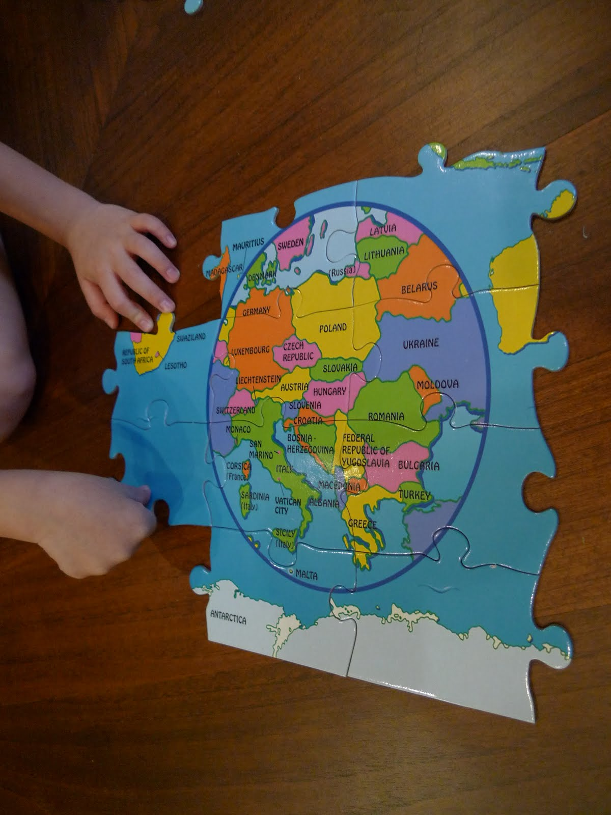The pig and rabbit world map puzzle i then let emily do that section of the puzzle herself using just the selected pieces this is emily working on the europe section of the map gumiabroncs Choice Image