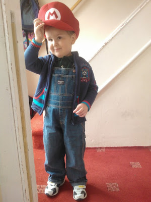 Big Boy dressed up as a Mario/Luigi hybrid