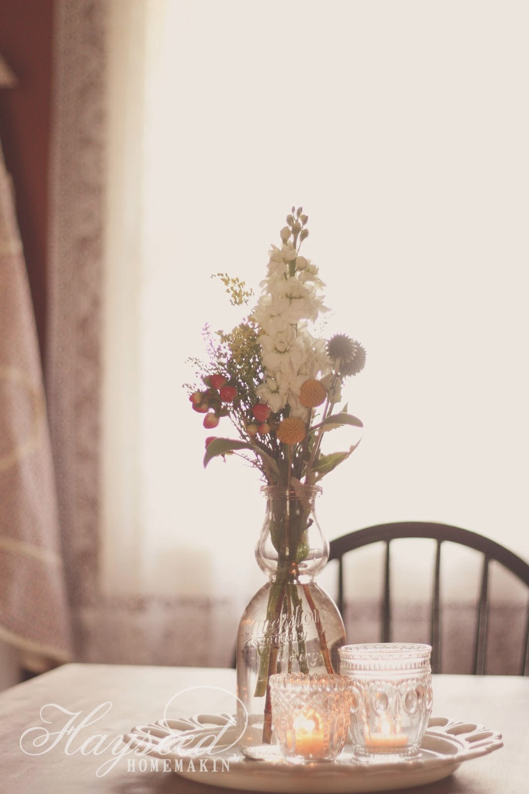 Hayseed homemakin milk bottle centerpiece
