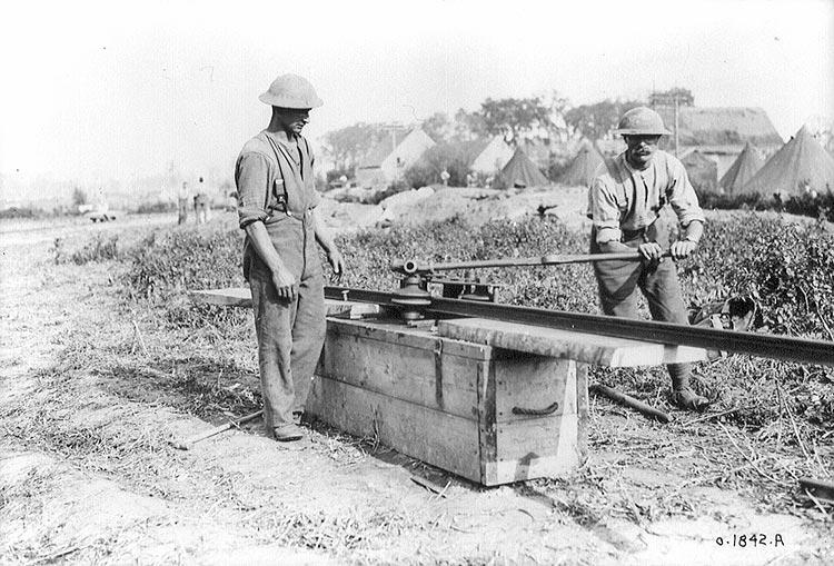 a machine gun is attached to a railroad flatcar