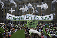 People hold a banner reading ' Climate action Now ' in St. Peter's Square, at the Vatican, Sunday, June 28, 2015. Voters in key swing states like Iowa say they agree with Pope Francis about climate action. (Photo Credit: AP/Andrew Medichini) Click to Enlarge.
