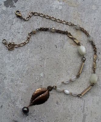 Upcycled necklace with leaf charm